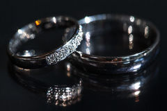 Free Wedding Day Details - Two Lovely Golden Wedding Rings Stock Photo - 76771820