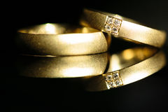 Wedding day details - two lovely golden wedding rings Royalty Free Stock Photo