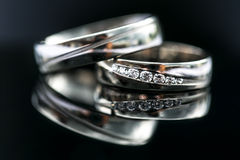 Wedding day details - two lovely golden wedding rings Stock Photos
