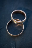 Wedding day details - two lovely golden wedding rings Stock Photo