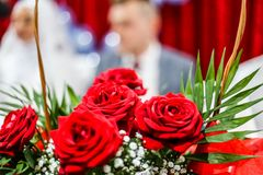 A wedding day, flowers in front of a bride, a red rose in a knit. Ted basket Royalty Free Stock Image