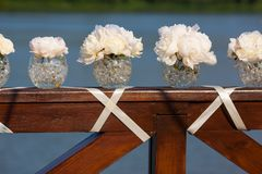 Wedding day flowers. Pink flowers wedding decorations. Beautiful peonies in vases Royalty Free Stock Image