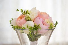 Wedding day flowers. Pink flowers wedding decorations. Beautiful peonies in vases Royalty Free Stock Photography