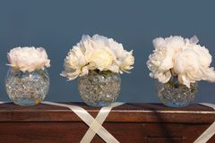 Wedding day flowers. Pink flowers wedding decorations. Beautiful peonies in vases Stock Photography