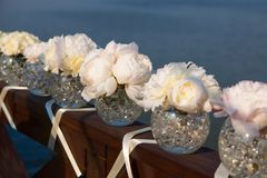 Wedding day flowers. Pink flowers wedding decorations. Beautiful peonies in vases Stock Photos