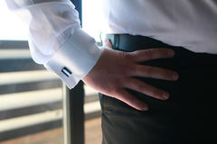 Wedding day groom preparing men wear button a shirt and cufflinks. Sunny day business man Royalty Free Stock Photography