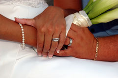 Wedding day hands. A couples hands together on their wedding day stock image
