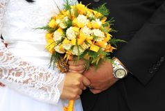 Wedding Day - Holding Hands with Bouquet - Philippine Sampaguita Flowers made by Groom`s Father stock photography