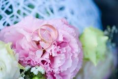 Wedding day for the newlyweds. Wedding attributes of the newlyweds. Wedding rings. Wedding bridal bouquet. stock images