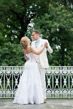 Wedding day outdoor. Happy bride and groom, love, tenderness. Royalty Free Stock Photo