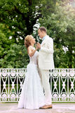 Wedding day outdoor. Happy bride and groom, love, tenderness. Royalty Free Stock Image