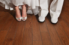 Bride and Groom Shoes. Wedding day, white and white shoes on bride and groom Stock Photos