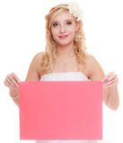 Wedding day. Woman bride holding sign red blank Stock Image