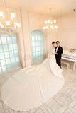 Wedding day of young asian couple Stock Photos