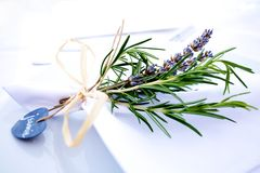 Wedding decor. Table decor at a wedding made of rosemary and lavender tied together with a straw bow Royalty Free Stock Images