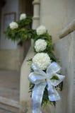 Wedding decor. On a doorway of a church Stock Photos