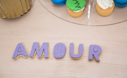 Wedding decor, AMOUR letters on table. AMOUR decoration on festive table. Luxurious wedding decoration on restaurant table. Elegant event royalty free stock photography