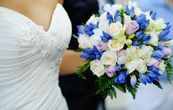 Wedding bouquet  in the hands of bride Royalty Free Stock Image