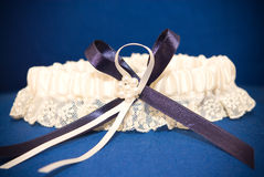 Wedding decor of blue garter with ribbon of lace Royalty Free Stock Image
