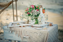 Wedding decor with bottle, glasses, flowers, sea cockleshells an Royalty Free Stock Images