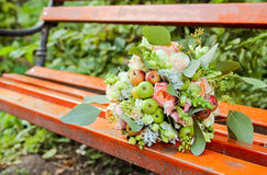 Wedding decor - a bowl of green apples, fresh flowers and lace ribbons Royalty Free Stock Photography