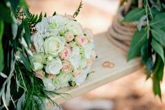 Wedding decor. A bridal bouquet on a decorative swing. stock photos