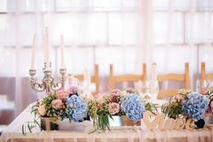 Wedding decor with candelabrum, blue and peach flowers. And wooden word love Stock Images