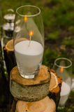 Wedding decor. Candles on the cut stumps Stock Images