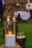 Wedding decor. Candles on the cut stumps Royalty Free Stock Photography