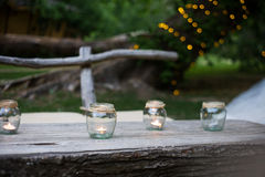 Wedding decor, candles in glass flasks Royalty Free Stock Image