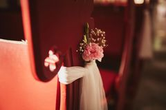 Wedding decor for chairs with flowers in church royalty free stock photos