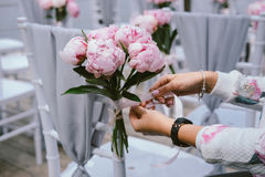 Wedding decor concept. Decoration chairs flowers Stock Photography