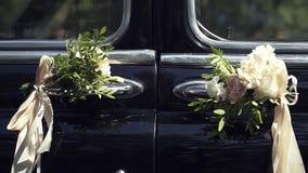 Flowers on the retro car. Wedding Decor.The Design of the Wedding Decorations. Flowers on the retro car stock video footage
