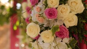 Wedding decor flower bouquets and compositions. Holiday floristics of white and pink roses stock video footage