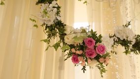 Wedding decor flower bouquets and compositions. Holiday floristics of white and pink roses stock footage