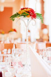 Wedding decor flowers bouquet on table. Wedding decor flowers on table in orange and green color Royalty Free Stock Image