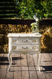 Wedding decor flowers commode Stock Photo