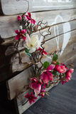 Wedding decor of flowers. Wedding decoration in the interior of flowers and wood material Stock Photos