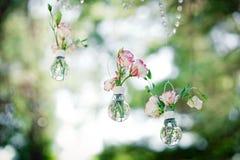 Wedding decor with  flowers of eustoma in bulbs. Stock Photos
