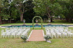 Wedding Decor Home. Wedding decor setup chairs ceremony on grass lawn cutlery glasses table on porch veranda at private home mansion Stock Image