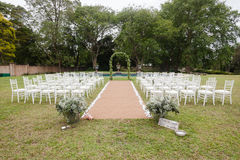Wedding Decor Home. Wedding decor setup chairs ceremony on grass lawn cutlery glasses table on porch veranda at private home mansion Royalty Free Stock Photos