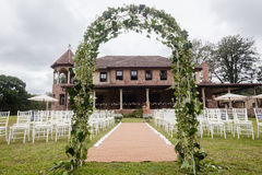 Wedding Decor Home. Wedding decor setup chairs ceremony on grass lawn cutlery glasses table on porch veranda at private home mansion stock photos