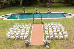 Wedding Decor Home. Wedding decor setup chairs ceremony on grass lawn cutlery glasses table on porch veranda at private home mansion royalty free stock images