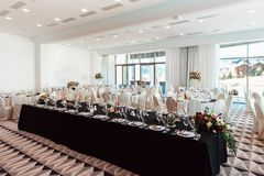 Wedding decor, interior. Festive. Banquet table. Modern wedding decorations. Tables served for the wedding stock photo