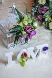 Wedding decor, LOVE letters and flowers on table. Fresh flowers and LOVE decoration on festive table. Luxurious wedding decoration. On restaurant table. Elegant stock photos