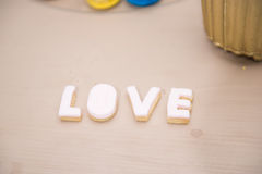 Wedding decor, LOVE letters on table. LOVE decoration on festive table. Luxurious wedding decoration on restaurant table. Elegant event stock photo