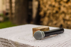 Wedding decor. The microphone and box for wedding ruts on the table Royalty Free Stock Image