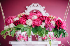 Wedding decor in pink with peonies. Love Stock Images