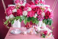 Wedding decor in pink with peonies. Love Stock Photos