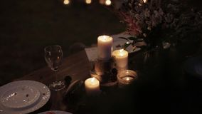 Wedding decor table. Beautiful composition candles bouquet table setting stock video footage